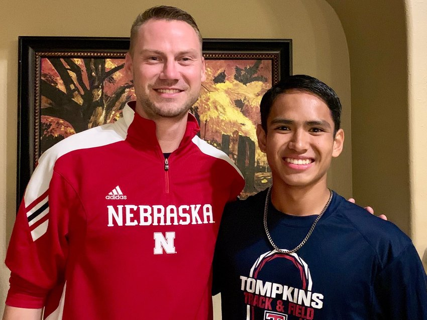 Tompkins senior Clayton Keys, right, is pictured with Nebraska assistant coach Dusty Jonas during a visit earlier this year.