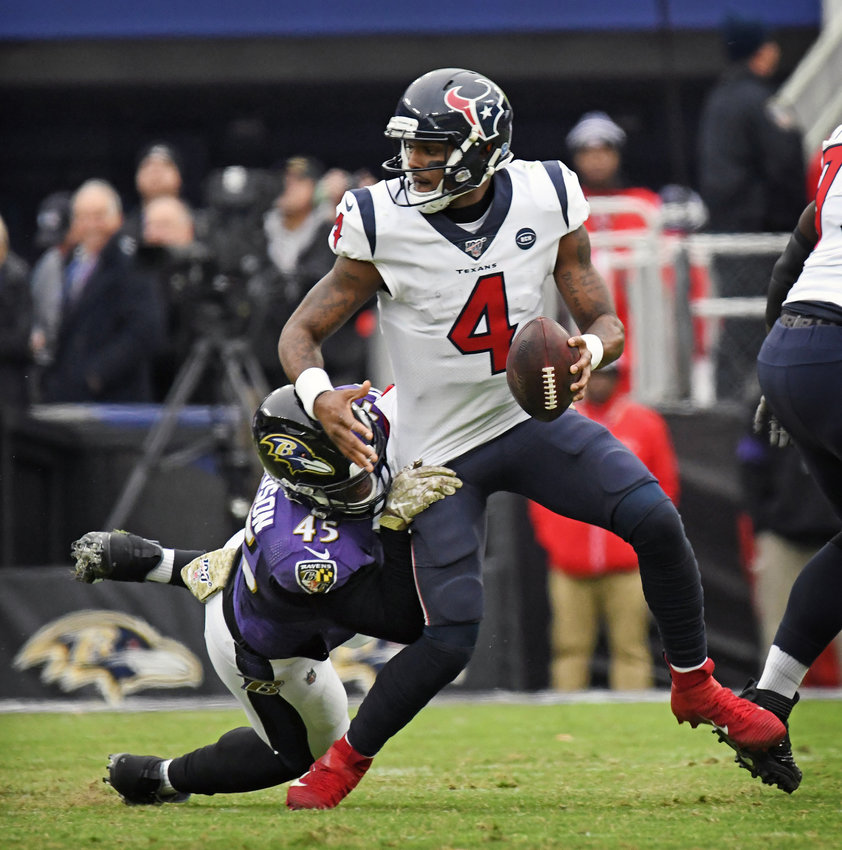 Ravens' Jaylon Ferguson, left, sacks Texans quarterback Deshaun Watson in the second quarter. The Ravens defeated the Texans by score of 41 to 7 at M & T Bank Stadium in Baltimore, MD. (Kenneth K. Lam/Baltimore Sun/TNS)