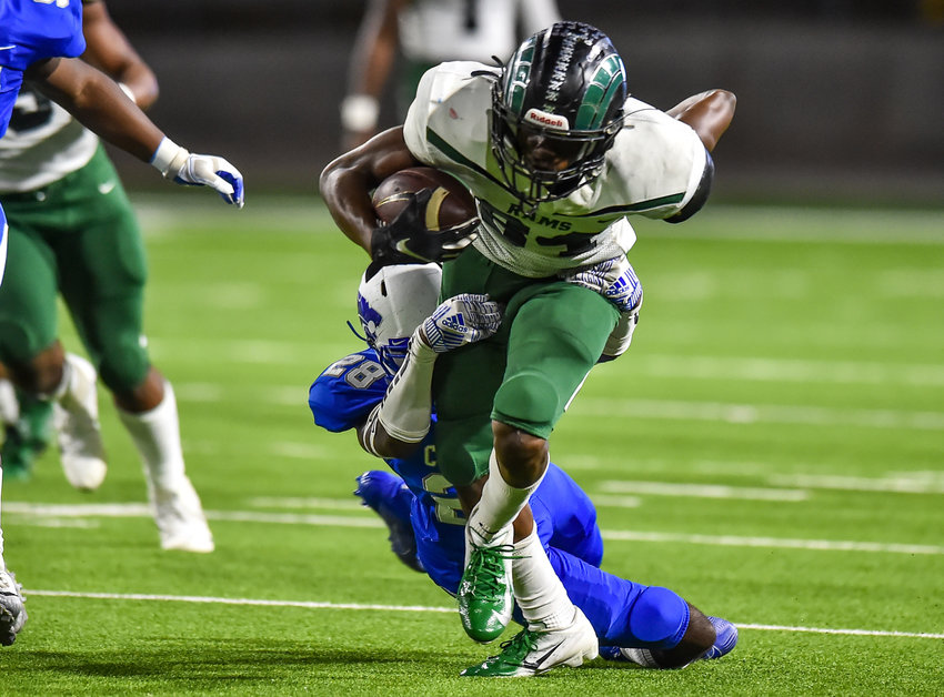 Cypress, Tx. Nov. 21, 2019: Mayde Creek's Tory Wilson (84) makes the reception carrying the ball for a first down during the area playoff game between Mayde Creek and Cypress Creek at Pridgeon Stadium. (Photo by Mark Goodman / Katy Times)