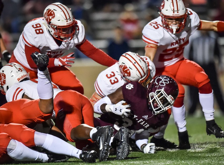 Houston, Tx. Nov. 22, 2019: Katy's Hagen Losa (33) makes the stop on Cy-Fair's Joseph Nguyen (4) during the area playoff game between Katy Tigers and Cy-Fair Bobcats at Tully Stadium. (Photo by Mark Goodman / Katy Times)