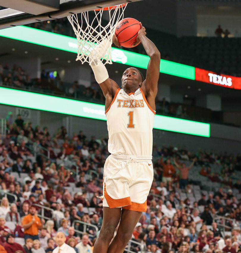 Texas Longhorns guard Andrew Jones (1) dunks the ball during an NCAA men's basketball game between Texas and Texas A&M at Dickie's Arena in Fort Worth, Texas, on Dec. 8, 2019. Texas won, 60-50.