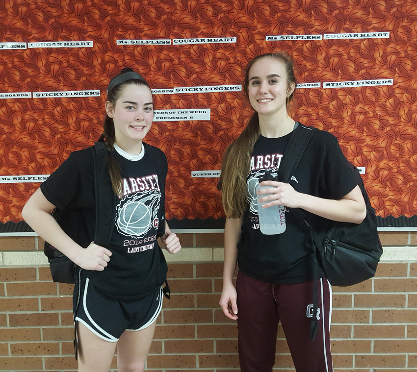 Cinco Ranch junior Abby Bala, left, and senior Catherine Hursh combined for 17 points and 12 assists in the Cougars' district-opening win over Mayde Creek on Friday, Dec. 13.