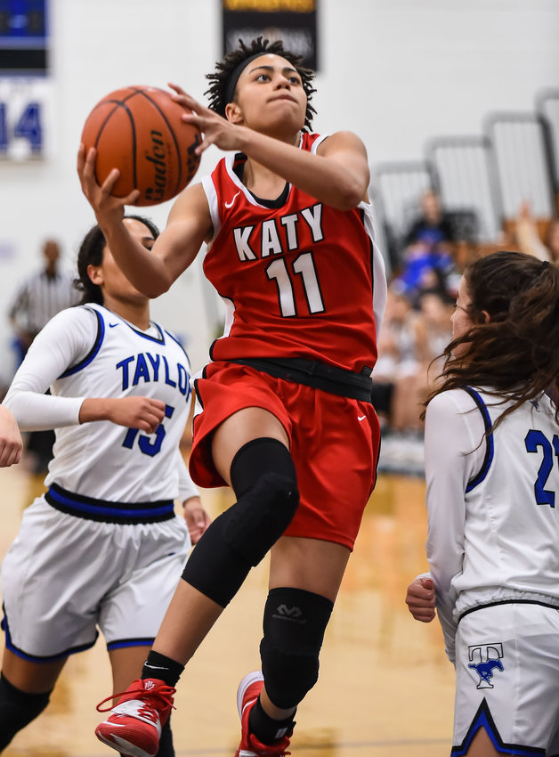 Katy Tx. Dec. 20, 2019: Katy's Allana Thompson (11) drives up the lane to the basket during a district basketball game between Katy Tigers and Taylor Mustangs at Taylor HS.  (Photo by Mark Goodman / Katy Times)