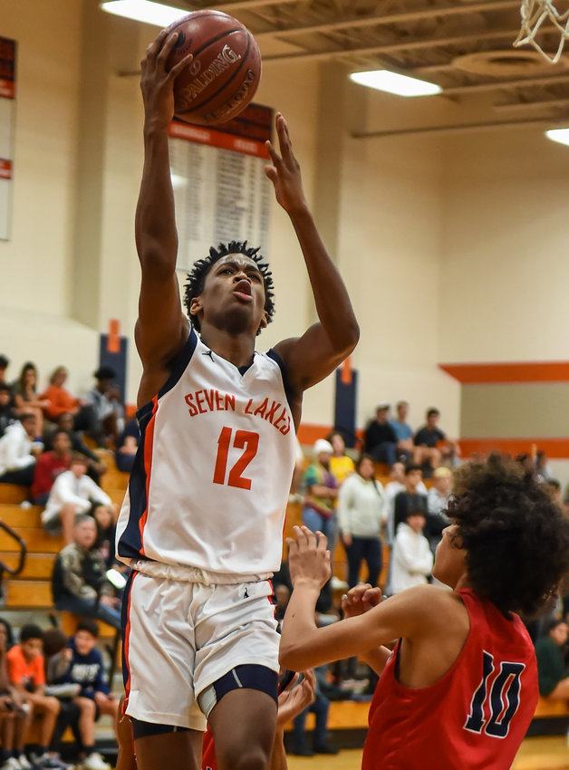 Katy Tx. Dec. 16, 2019: \sl12 drives to the basket during non-district basketball game between Seven Lakes Spartans and Pearland Dawson Eagles at Seven Lakes HS.  (Photo by Mark Goodman / Katy Times)
