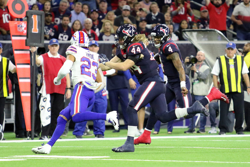 Houston Texans fullback Cullen Gillaspia (44) blocks for quarterback Deshaun Watson (4) on Watson's 20-yard touchdown run in the third quarter of the Texans' AFC Wild Card playoff win over the Buffalo Bills on Saturday, Jan. 4, at NRG Stadium.