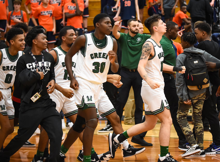 Katy Tx. Jan. 14, 2020:  Rams celebrate a victory after Mayde Creek's Anthony Pelzer (30) scores the winning basket during a district basketball game between Seven Lakes Spartans and Mayde Creek Rams at Mayde Creek HS.  (Photo by Mark Goodman / Katy Times)