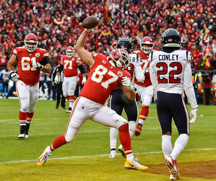 Kansas City Chiefs tight end Travis Kelce spikes the ball after scoring his first touchdown of the second quarter against the Houston Texans Sunday, Jan. 12, 2020, at Arrowhead Stadium in Kansas City, Mo. (Jill Toyoshiba/Kansas City Star/TNS)