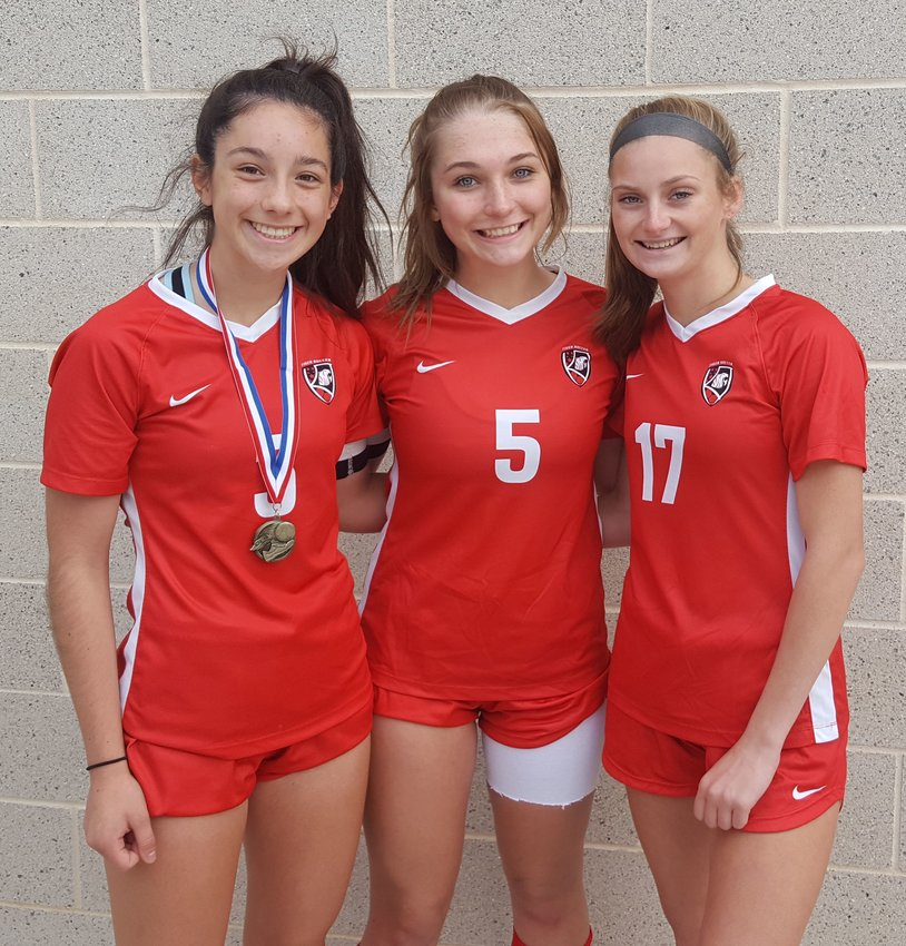 Katy girls soccer captains Yamila Lara, Grace Hunter and Alison Spavale pose for a photo following the team's 2-0 victory in the championship round of the Tigers' bracket in the I-10 Shootout on Jan. 11 at Legacy Stadium.