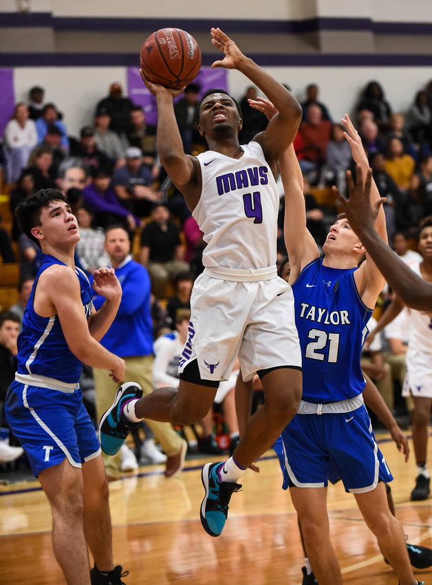 Katy Tx. Jan. 21, 2020: Morton Ranch's LJ Cryer (4) drives to the basket during district basketball game between Taylor Mustangs and Morton Ranch Mavericks at  MRHS.  (Photo by Mark Goodman / Katy Times)