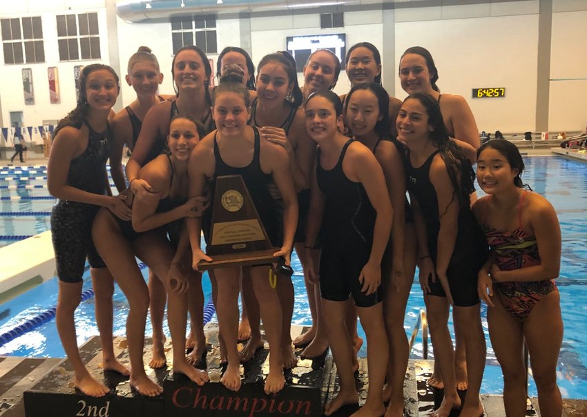 Taylor High's girls swimming team won its second straight Region V-6A championship, nipping Seven Lakes, on Saturday, Feb. 1, in Cypress.
