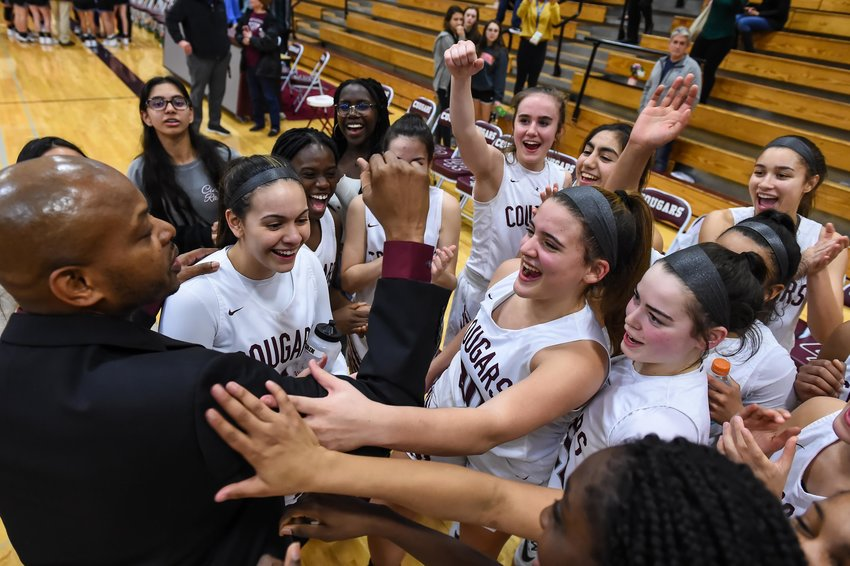 Katy Tx. Feb 11, 2020: The Lady Cougars get a few words from Cinco Ranch's Dwayne Archangel (head coach) as they clinch a playoff spot with a win over Katy Taylor during a district basketball game between Cinco Ranch Cougars and Taylor Mustangs at Cinco Ranch HS.  (Photo by Mark Goodman / Katy Times)