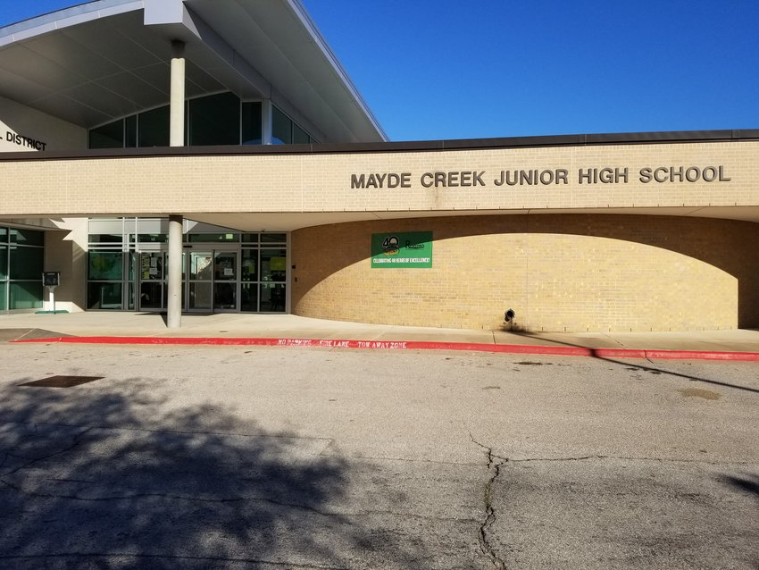 A cell phone battery began smoking at Mayde Creek Junior High School on the eastern side of Katy ISD's territory Friday morning. The incident caused ten students to be taken to area hospitals for treatment for smoke inhalation.