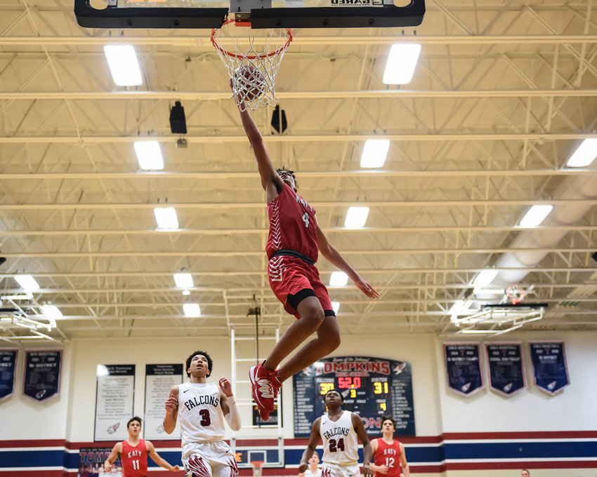 Katy Tx. Jan. 10, 2019: Katy's Dayvaughn Froe (4) drives up the lane to the basket during a district basketball game between Tompkins Falcons and Katy Tigers at Tompkins HS.  (Photo by Mark Goodman / Katy Times)