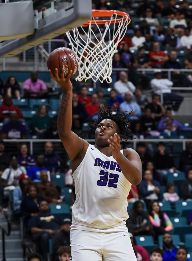 Katy Tx. Feb 24, 2020: Morton Ranch's Eddie Lampkin (32)  goes up for the shot under the basket during natural playoff game between Morton Ranch Mavericks and Fort Bend Elkins Knights at the Merrell Center in Katy.  (Photo by Mark Goodman / Katy Times)
