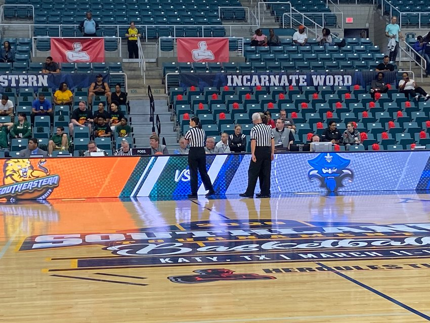Game officials wait at the scorer's table to hear word on a decision from Southland Conference presidents prior to tip-off of the Southeastern Louisiana-New Orleans women's basketball game at the Merrell Center in Katy. It was ultimately decided to cancel the tournament.