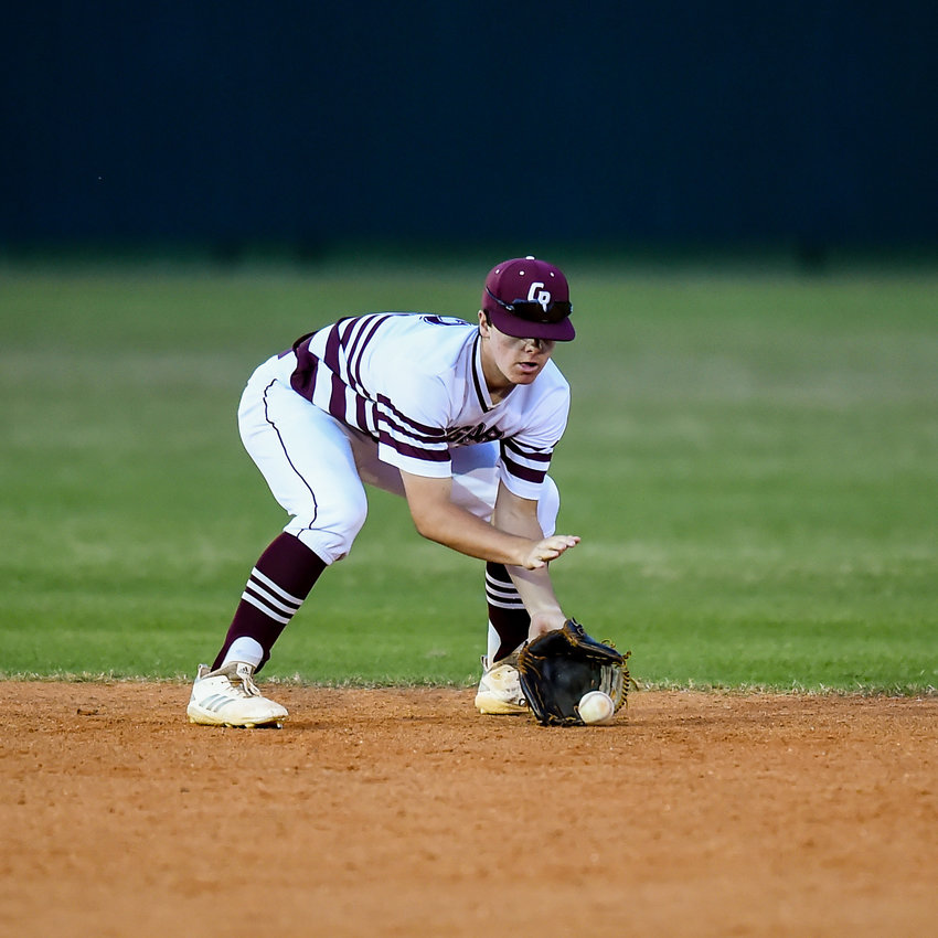 Katy Tx. March 10, 2020: Cinco Ranch's Logan Henderson #2 fields a ball during a game between the Cinco Ranch Cougars and Clear Lake Falcons at Cinco Ranch HS. ( Photo by Mark Goodman / Katy Times )