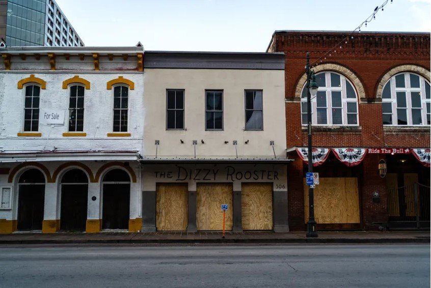 Bars are shuttered on Austin's Sixth Street during the COVID-19 pandemic.
