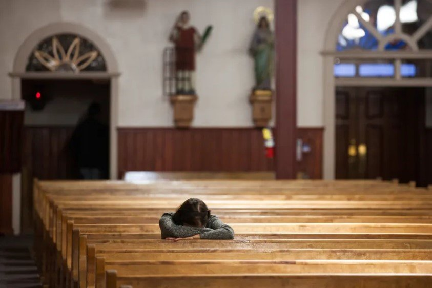 A parishioner prays in a church in Texas.