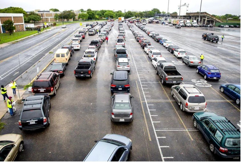 More than 3,000 vehicles lined up at Northeast Early College High School in Austin on April 4 to pick up boxes of food.