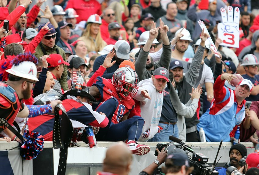 The XFL announced Friday morning that it is suspending operations indefinitely and laying off all employees although a small contingency of executives will remain working at headquarters in Stamford, CT. The season was halfway over and the Houston Roughnecks were still undefeated at 5-0. Pictured is Roughnecks running back James Butler leaping into the stands after scoring a touchdown against the Seattle Dragons on March 7.