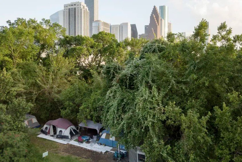 A large homeless camp near downtown Houston in 2019. Mayor Sylvester Turner said homeless shelters have become a hot spot for coronavirus. Health officials advise against moving homeless encampments during the pandemic, though they suggest homeless people have 144 square feet of space per person
