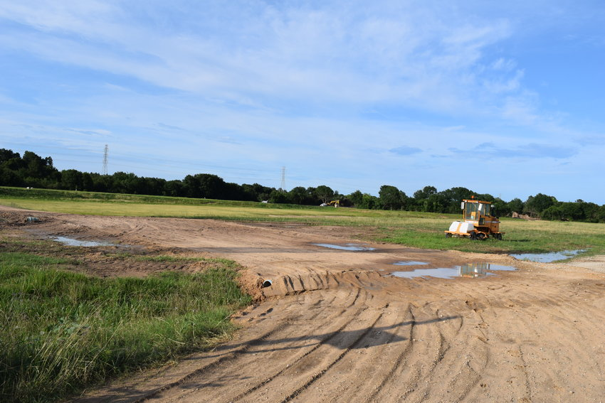 The expansion of the Pitts Road Detention Pond located at the intersection of Morton and Pitts roads is part of Proposition B in the 2018 drainage bond package approved by city of Katy voters. Above, the equipment to expand the pond sits idle on Memorial Day but work is progressing on the pond, Katy officials said.