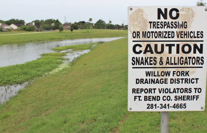 Willowfork Drainage District's manmade channel helps convey water from the Katy area to Barker Reservoir to alleviate flooding during severe storms. After Hurricane Harvey, channels across the Katy area were blocked with sediment and silt, prompting many removal projects.