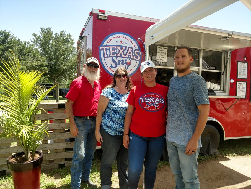 Texas Sno is a family-owned business that offers a variety of flavors in their sno cones, including some dye-free flavors. The dessert food trailer offers treats from its location at ErmaRose Winery. Pictured from left to right are owners Giles Debenport, Kristen Debenport, Kelsie Dartayet and Travis Debenport. Texas Sno can be reached at 346-377-9436 or visit them online at www.texassno.com.