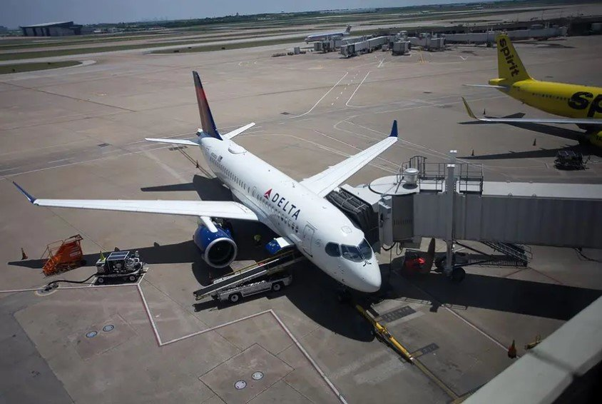 A Delta Air Lines Airbus A220 jet waits between flights at Dallas/Fort Worth International Airport.