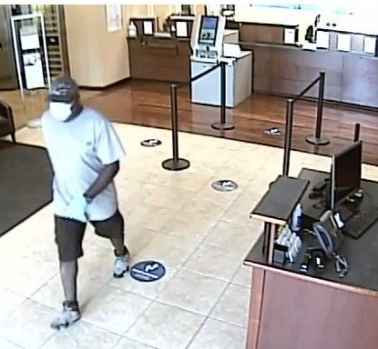Security footage shows the suspect fleeing the bank after the robbery.