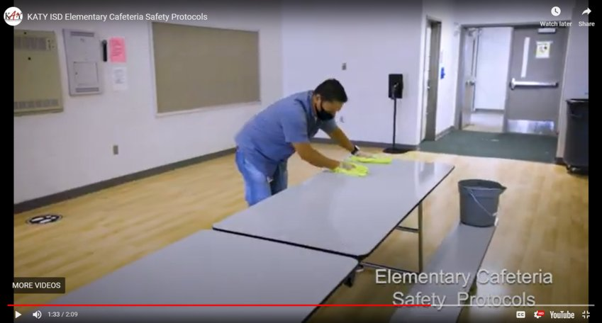 Katy ISD's new safety videos highlight steps the district is taking to ensure campuses remain sanitary for students during the COVID-19 pandemic. In this screen capture, a KISD employee sanitizes a cafeteria table after use to demonstrate the additional sanitation steps the district will be taking once campuses reopen.