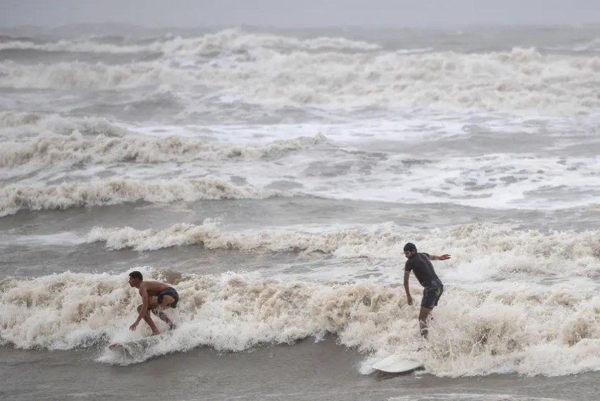 Surfers rode high swells from Hurricane Hanna in Galveston in July. The city is currently under mandatory evacuation in anticipation of Hurricane Laura.     From Galveston to the Louisiana border, Texas communities are telling residents to seek shelter away from the coast as Laura is projected to intensify into a Category 3 hurricane.