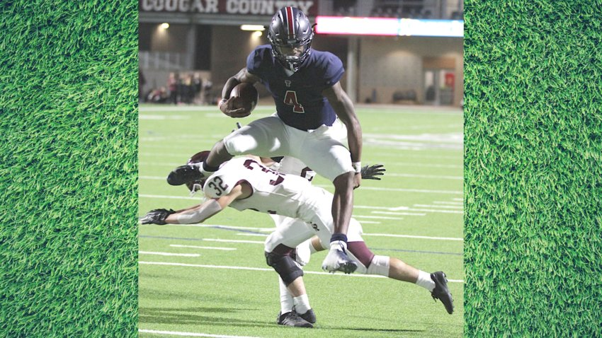 Tompkins quarterback Jalen Milroe recently announced a switch in his college decision and said after much thought with his family, the University of Alabama was the right next step for him to take after his Falcons' career closes at the end of this year. Pictured is Milroe hurdling a Cinco Ranch defender en route to the end zone in a 58-0 win to end the regular season.