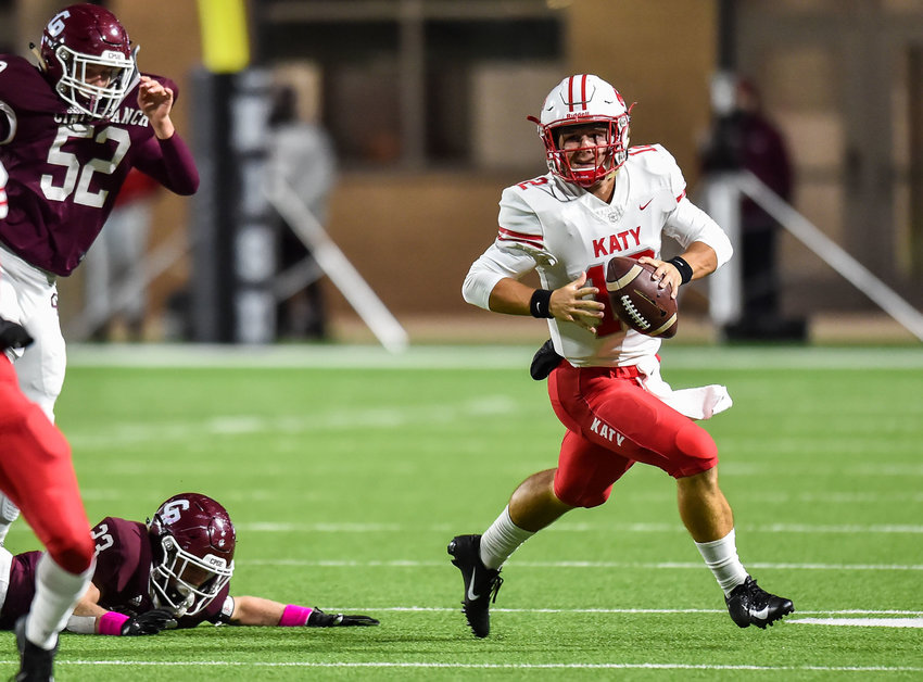 "Senior Bronson McClelland returns to run the Katy Tigers' offense as a top-25 quarterback recruit according to ""Dave Campbell's Texas Football Magazine."" Pictured is McClelland escaping the pocket during a conference game between Katy and the Cinco Ranch Cougars at Legacy Stadium Oct. 25, 2019."