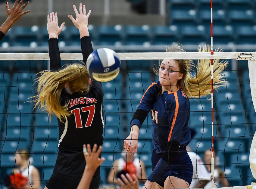 Seven Lakes' Ally Batenhorst, voted the most outstanding hitter for District 19-6A last year, recently collected national preseason recognition from MaxPreps and the American Volleyball Coaches Association. Pictured is Batenhorst, 14, delivering a spike past Fort Bend Austin's Sydney Plemons, 17, during a high school volleyball playoff match at the Merrell Center in Katy on Nov. 5, 2019.