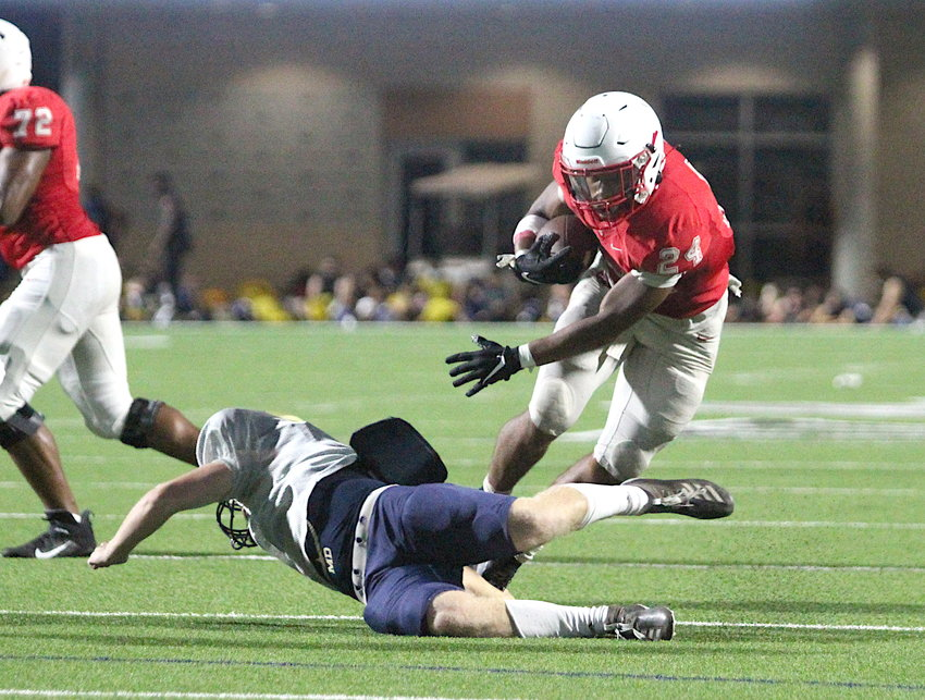 Football returned to the Katy area last night with teams participating in their first and only interscholastic scrimmage ahead of the delayed regular-season opener next Friday. The Katy Tigers hosted the Klein Collins Tigers at Legacy Stadium and will travel to play Clear Springs next week. Pictured is Katy running back Jalen Davis making a Klein Collins defender miss in the red zone.