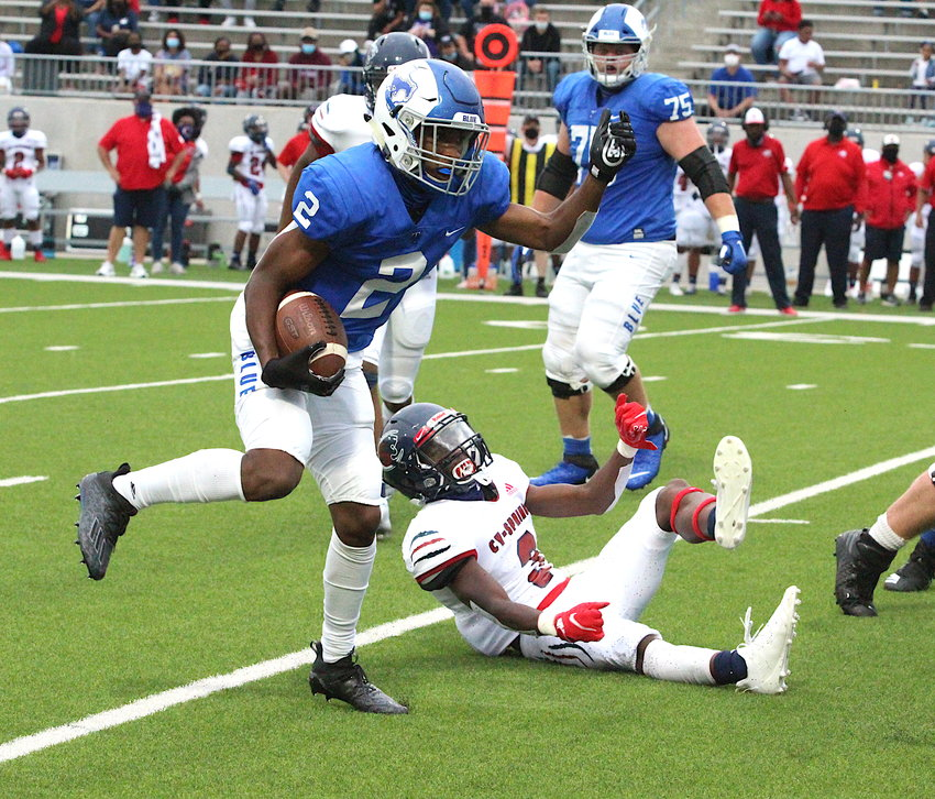 Taylor junior Michael Whitaker carries the ball during Thursday's game against Cy-Springs at Legacy Stadium.