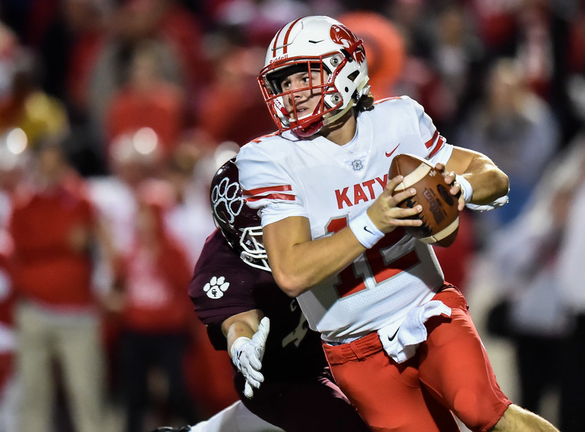 Houston, Tx. Nov. 22, 2019: Katy's QB Bronson McClelland (12) scrambles out of the pocket during the area playoff game between Katy Tigers and Cy-Fair Bobcats at Tully Stadium. (Photo by Mark Goodman / Katy Times)