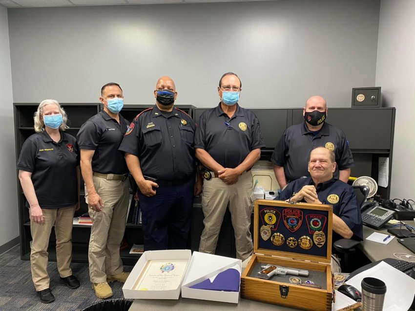 Jinks' coworkers honored him with a box containing a sidearm and memorabilia of his time in law enforcement.