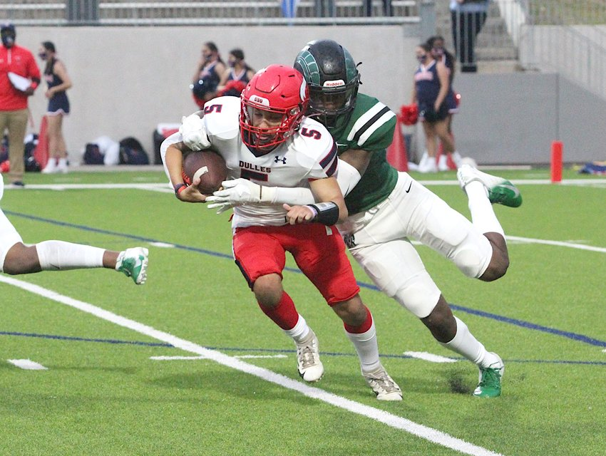 Mayde Creek defensive lineman Gregory Meeks II chases down Dulles quarterback Ryan Alaniz for a sack in a non-district game against the Vikings at Legacy Stadium in Katy on Oct. 8, 2020.