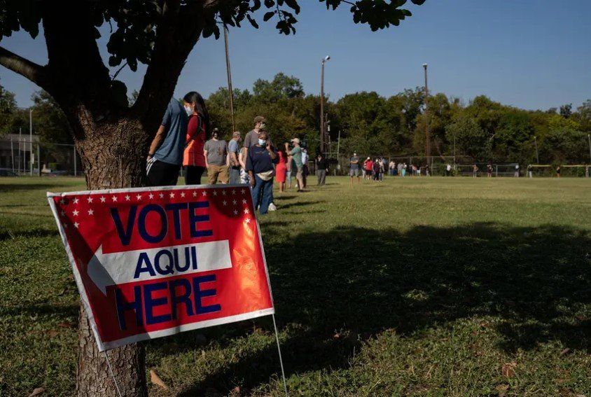 Voters wait to cast their ballot at the South Austin Recreation Center on the first day of early voting in Texas. Meanwhile, voting machines were temporarily down in Fort Bend County on Tuesday morning, but a county official said the problems were fixed by the afternoon.