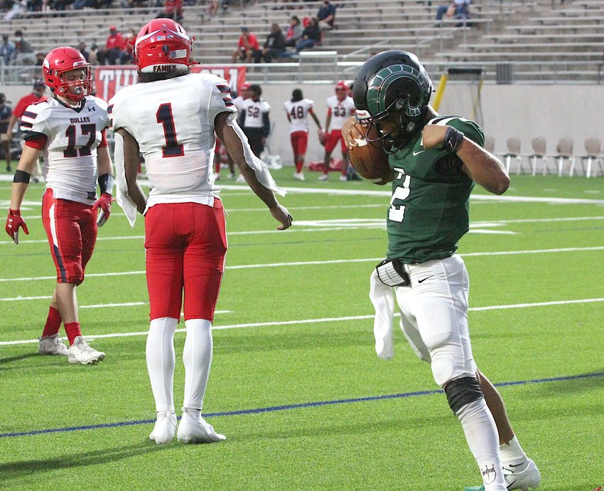 Senior quarterback Jace Wilson (right, pictured celebrating a touchdown during last week's win against Dulles) and the Mayde Creek Rams jumped into the Houston area high school football media poll this week, coming in at No. 19.