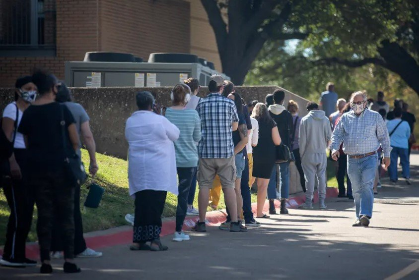 People waited in line to vote in Dallas on Tuesday, the first day of early voting.