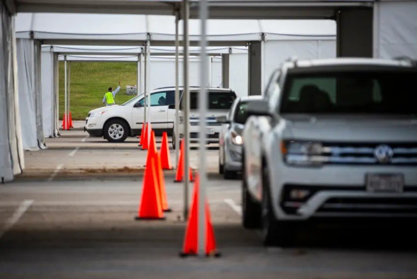 Cars lined up to vote in the drive-thru line at NRG Stadium in Houston during the first day of early voting on Oct. 13, 2020. The judge's ruling follows two related decisions by the Texas Supreme Court rejecting efforts to have Harris County's drive-thru voting process deemed illegal. It appears to clear the way for all drive-thru votes to be counted on Election Day tomorrow.