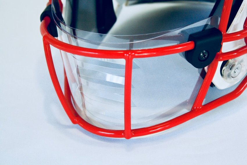 Starting with Thursday's game against Tompkins at Legacy Stadium, Katy High's football players will have the option of using a unique safety shield on their helmets. The shield, created by Third Coast Shields, is attached to the facemask and designed to reduce the spread of airborne droplets, adding additional barriers for player protection.