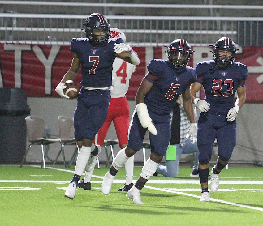 Tompkins senior defensive back Dru Polidore celebrates after his second-half interception during the Falcons' 24-19 win over Katy on Thursday evening at Legacy Stadium.