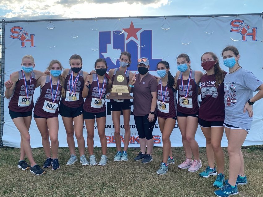 Cinco Ranch's girls won the Region III-6A cross country team championship on Tuesday afternoon in Huntsville. Senior Sophie Atkinson, holding the team regional championship trophy, finished first.