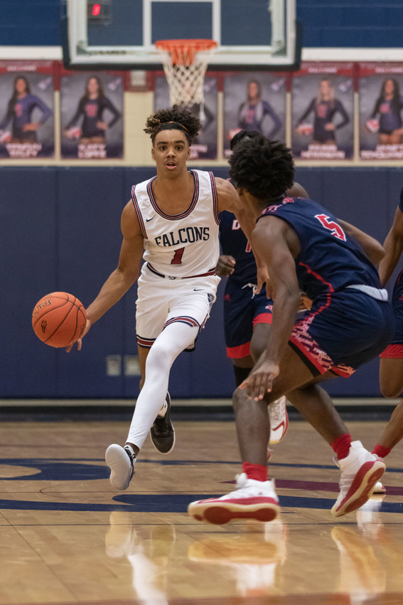 Tompkins guard B.B. Knight II dribbles upcourt during a game against Aldine Davis on Nov. 17 at Tompkins High.