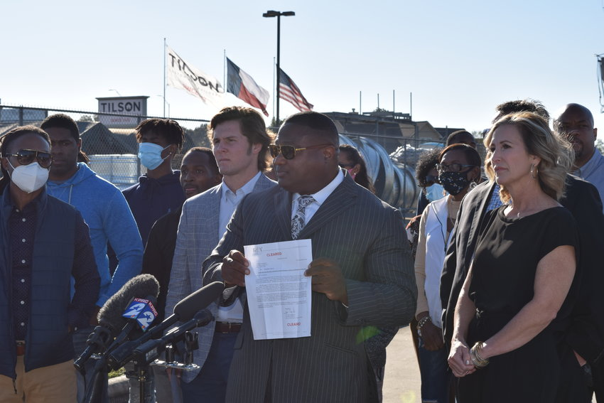 Bronson McClelland (gray jacket) stands behind Quanell X, a spokesman for the McClelland family at a press conference held Nov. 18 near Katy ISD's Education Support Complex while his parents Angie McClelland (far right) and Colburn McClelland (behind Angie) observe. The McClellands were joined by several of Bronson's supporters who vouched for Bronson's character in statements made to the press.