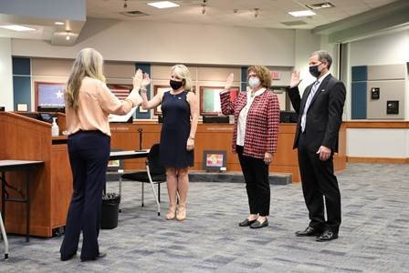 Ashley Vann (left), Leah Wilson (center) and Greg Schulte (far right) are sworn into office after winning their respective KISD Board of Trustees seats Nov. 3.